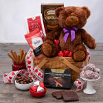 Basket with teddy bear and chocolate for Valentines day