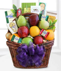 Woven gift basket filled with fresh fruit, cheese and gourmet foods