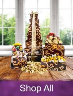 Gift towers filled with chocolate, snacks and treats in stackable keepsake boxes