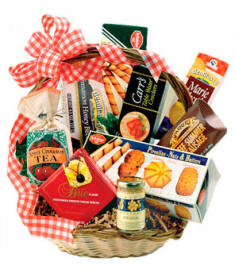 Wicker Gift Basket Filled with Jams, Jellies, Crackers, Sausage, Chocolate and other gourmet foods.